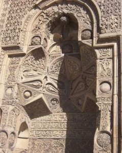Shadow of man reading cast by design in Divrigi Ulu mosque, Sivas, Turkey