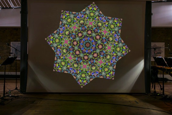 Projection from live performance of A Hidden Order by Sama Mara and Lee Westwood