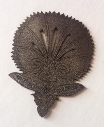 Flower motif laser cut from metallic cow leather